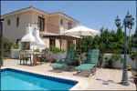 Swimming pool area in Oroklini villas in Cyprus for holiday rental