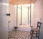 Kapides Agrotourism property in Cyprus - A delghtfull village house for holiday rentals in Cyprus. - the bathroom has plenty of old world charm  and a sunken bath - click to enlarge
