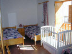 A triple room with baby cot