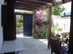 The courtyard with pergola for those sunny days at Lania Villa in Cyprus